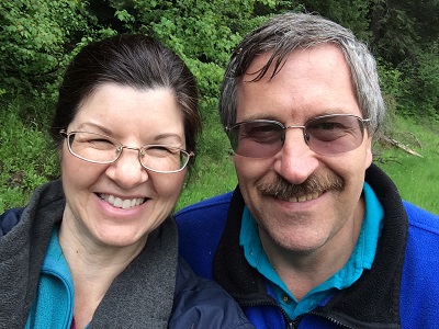 Angela and her hubby, Mike, drenched in the rain on one of their romantic national park bike and hikes.
